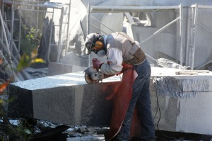 Shaping and refining the surface of the white granite using angle grinder
